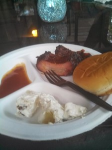 Kelly Gee knows how to smoke a rib.  Potato salad is at the bottom and to the right is the bourbon sauce